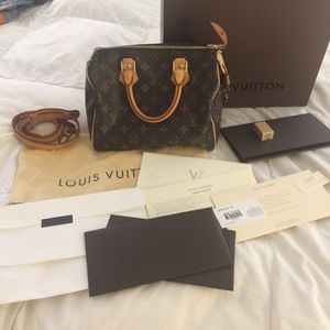 Louis Vuitton Speedy 25 bag and shoulder strap